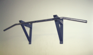 there is a wall attached black pull up bar