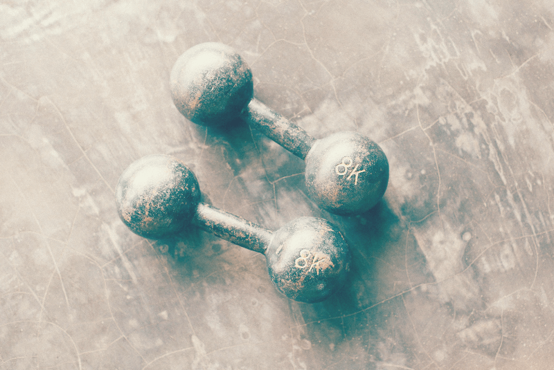 a set ot dumbells on the floor