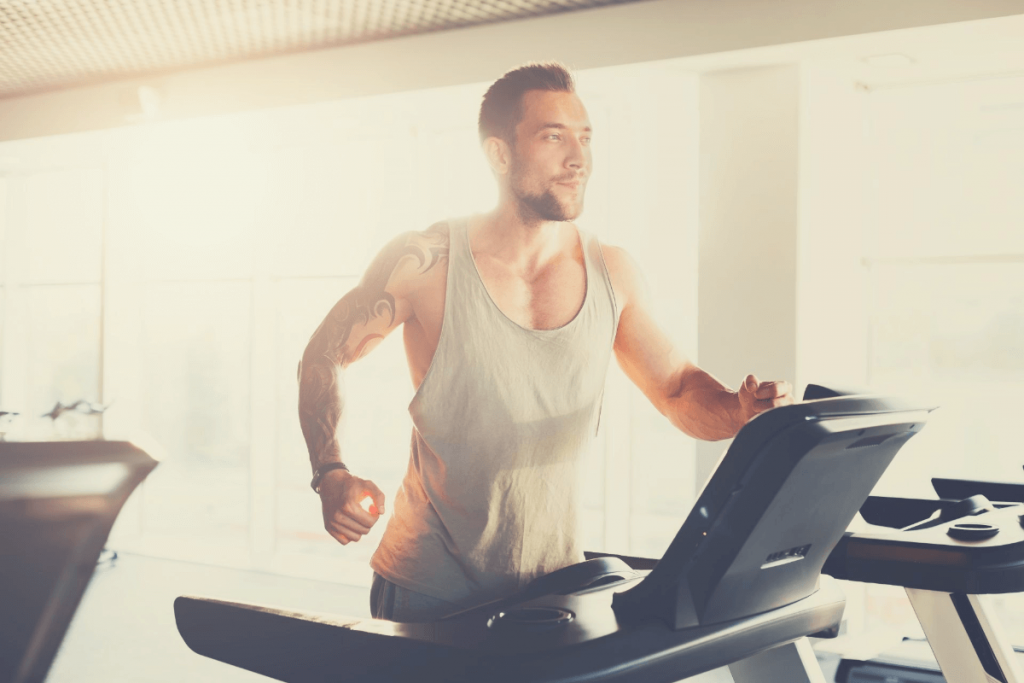 man running on a treadmill at home