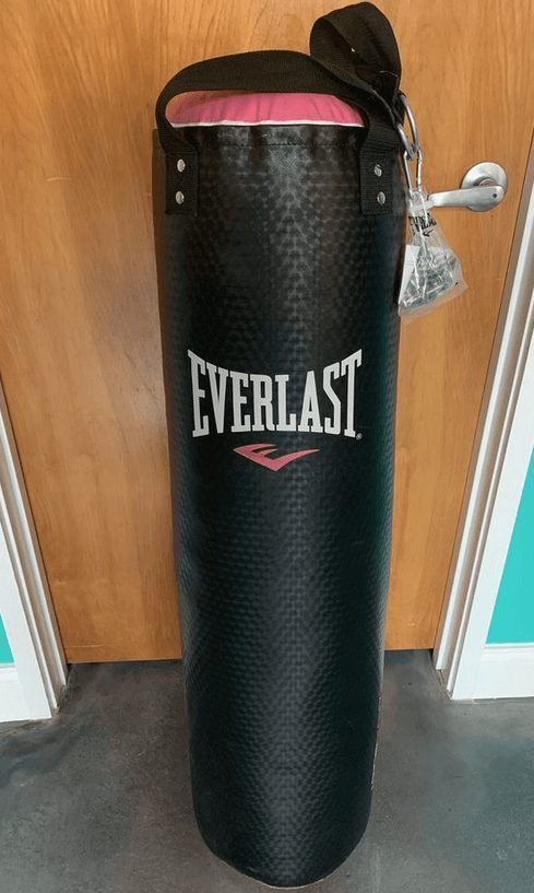 My girlfriend's pink punching bag