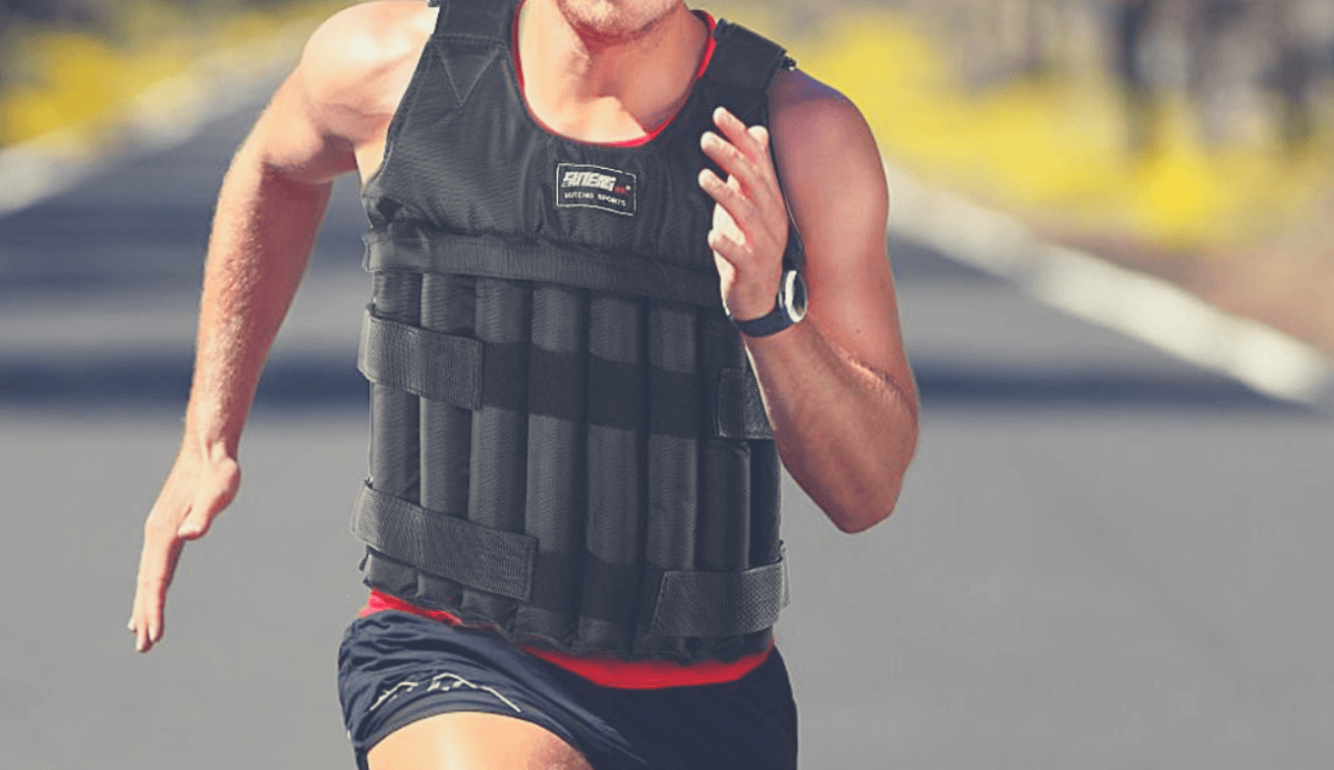 woman runing down a street while wearing a weighted vest